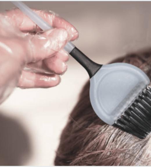 Disposable polythene gloves Hairdresser using
